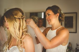 bride having hair adjusted