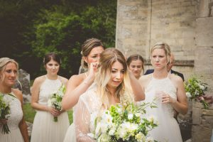 maid of honour adjusting brides hair