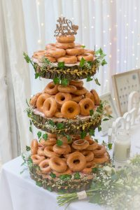 donuts on cake stand at wedding