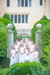 bridal party on steps at owlpen manor