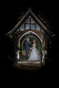 bride and groom under archway at owlpen manor