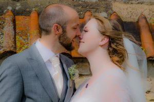 kissing couple at wedding in minsterworth Gloucestershire