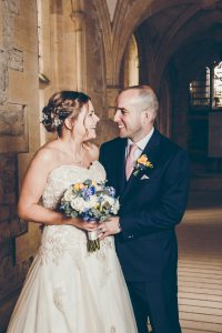 bride and groom in corridors at woodchester mansion
