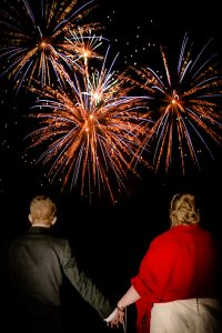bride and groom watching fireworks at tortworth court wedding photography