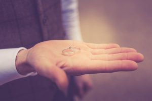 wedding rings in hand