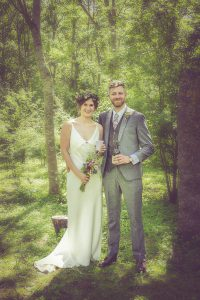bride and groom in cirencester woods