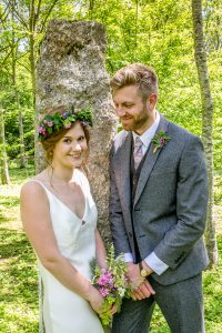 bride and groom in the woods