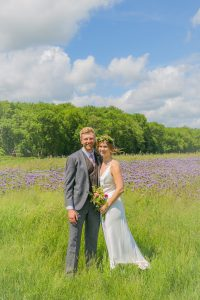 cirencester couple in field at wedding