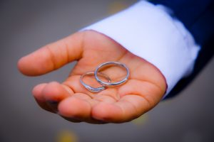 wedding rings in palm of best man