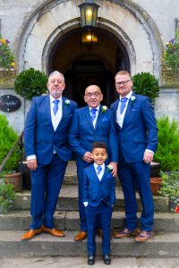 groomsmen on steps at stonehouse court