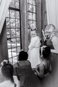 bridesmaids wait for bride at window