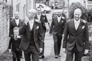 groom party walking to church