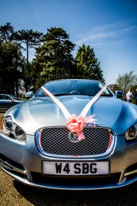 blue jaguar wedding car