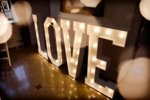illuminated LOVE sign at wedding