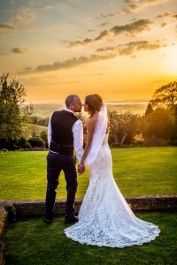 Wedding couple with severn bridge at sunset
