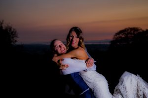 groom holding bride at sunset photography