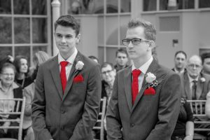 groom and best man at alter