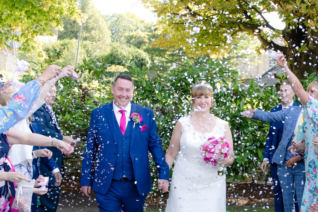Wedding photography couple confetti shot